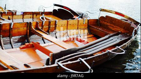 Wooden Rowing Boat on a lake - filter applied - Stock Photo