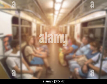 piople in subway train, blured - Stock Photo
