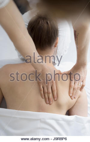 Overhead view woman receiving massage - Stock Photo