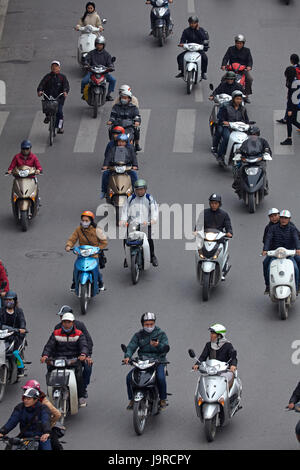 Busy street filled with motorcycles, Hanoi, Vietnam - Stock Photo