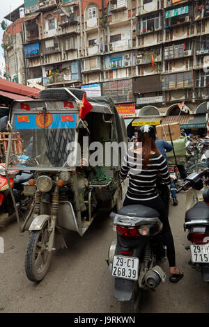 Tuktuk, motorbikes and apartments, Old Quarter, Hanoi, Vietnam - Stock Photo