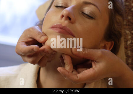 Wellness,woman,bathrobe,facial massage,portrait, - Stock Photo