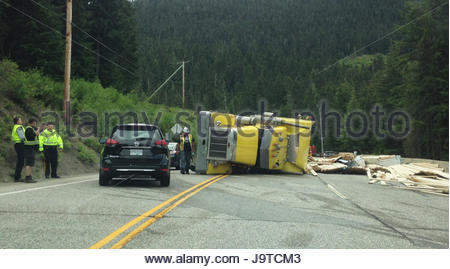 E. C. Manning Provincial Park, Highway 3, British Columbia, Canada. 2nd June 2017. An overturned heavy truck sheds - Stock Photo