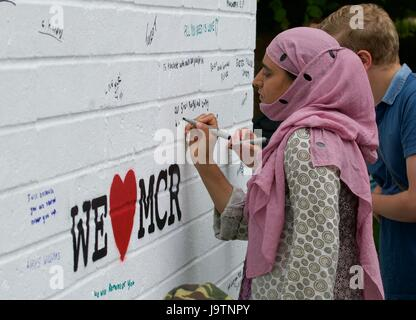 Exeter, UK. 3rd June, 2017. Musarat writes on the We Love Manchester wall on the Saturday of the Exeter Respect - Stock Photo