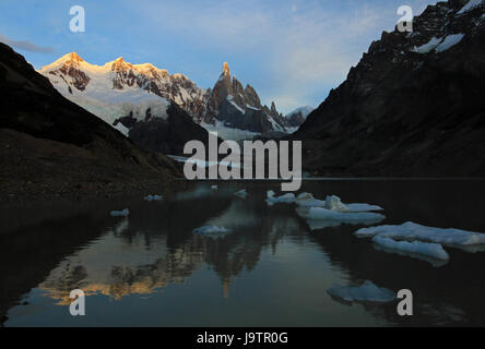 Reflection of Cerro Torre in Laguna Torre, Patagonia, Argentina - Stock Photo
