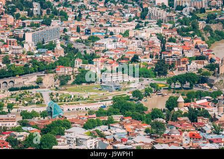Tbilisi, Georgia - May 20, 2016: Aerial View Of Bridge Of Peace, New Modern Glass Construction Over The Kura Mtkvari - Stock Photo
