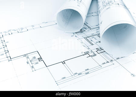 Blueprints; Floor Plan Drawing With Rolls Of Architectural Blueprints    Stock Photo