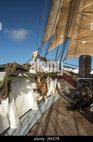 Jib sails and bowsprit on an old sailing ship at sea, taken on a sunny day off the coast of Mull in Scotland - Stock Photo
