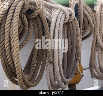 Coils of hemp rope forming part of the rigging on an old sailing ship - Stock Photo