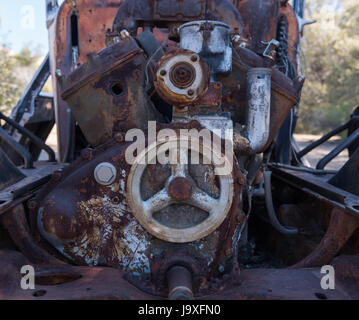 Rusted Engine in the Desert on an old mining site - Stock Photo