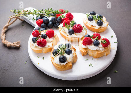 Cup of coffee with fruit sandwiches - Stock Photo