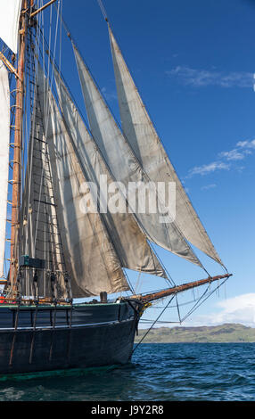 Twin masted sailing ship off the island of Kerrera, Oban, Scotland taken offshore from Gylan Castle - Stock Photo