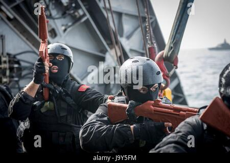 Moroccan Navy sailors participate in an Proliferation Security Initiative scenario aboard the USN Spearhead-class - Stock Photo