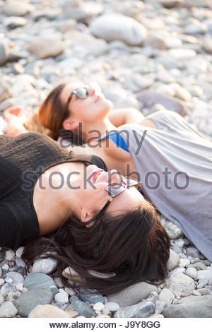 Young women relaxing on beach - Stock Photo