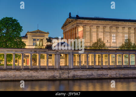 The Old National Gallery with the river Spree in Berlin at night - Stock Photo