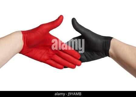a red and a black painted hand in handshake gesture, isolated - Stock Photo