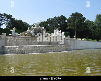 neptune fountain in schoenbrunn palace park - Stock Photo