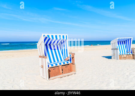 Wicker chairs on white sand Kampen beach, Sylt island, North Sea, Germany - Stock Photo