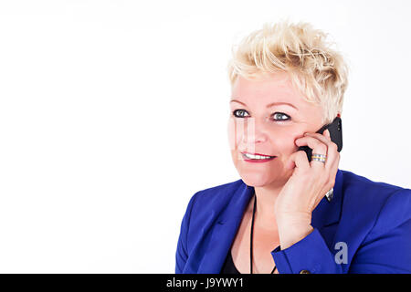 middelaged business woman in jacket talking on the phone - Stock Photo