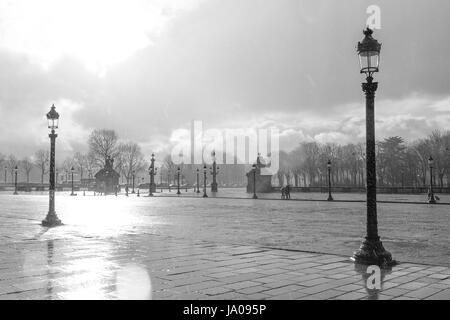 Rainy day in Place de la Concorde, Paris. - Stock Photo