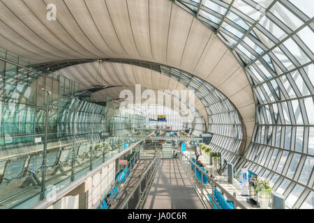 SAMUT PRAKAN, THAILAND - MAR 1, 2016 : Passenger Building of Suvarnabhumi Airport is one of two international airports - Stock Photo
