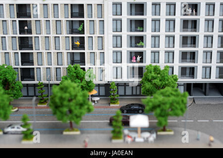 Miniature model, miniature toy buildings, cars and people. City maquette. - Stock Photo