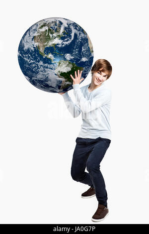 globe, planet, earth, world, possession, holding, young, younger, man, guy, - Stock Photo