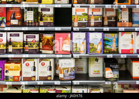 Wine boxes for sale in a French supermarket. - Stock Photo