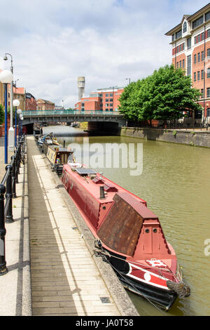 Bristol, England - July 17, 2016: Narrowboats docked at Temple Quay in Bristol's Floating Harbour. - Stock Photo
