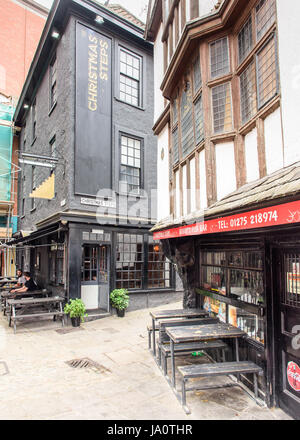 Bristol, England - July 17, 2016: The historic narrow alleyways of Christmas Steps in central Bristol. - Stock Photo