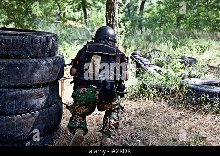 fight, fighting, battle, soldier, force, protect, protection, action, helmet, - Stock Photo