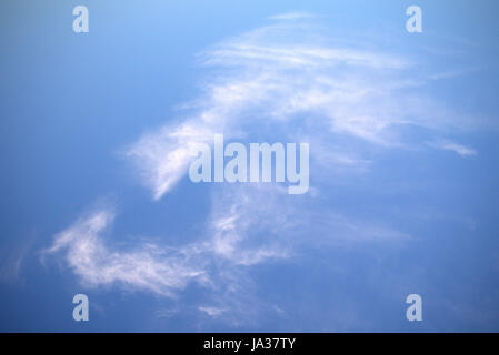blue sky cirrus clouds white mans face or mask  natural not Photoshop - Stock Photo