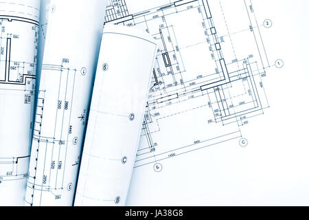 Architectural Drawing Blueprint floor plan drawings with architectural blueprint rolls on wooden