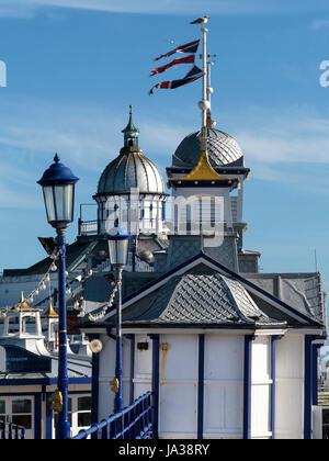Ornate fishscale zinc roofs with domed cupolas and finials, Eastbourne Pier, East Sussex, England, UK - Stock Photo