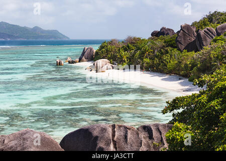 High angle view of the famous Anse Source D'Argent in La Digue, Seychelles from an observation point with granite - Stock Photo