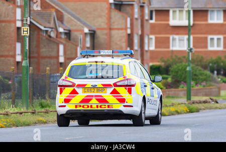 Sussex police car patrolling on a road in the UK. - Stock Photo
