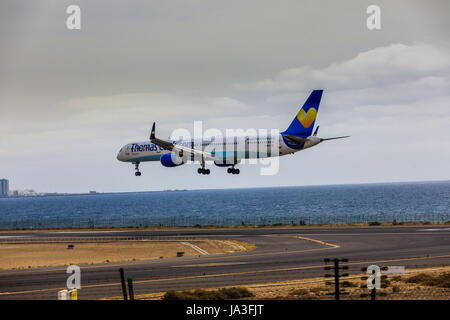 ARECIFE, SPAIN - APRIL, 15 2017: Boeing 757-300 of ThomasCook.com with the registration G-JMAA landing at Lanzarote - Stock Photo