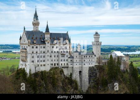 Neuschwanstein castle, view from Marienbrucke bridge, the famous viewpoint in Fussen, Germany - Stock Photo