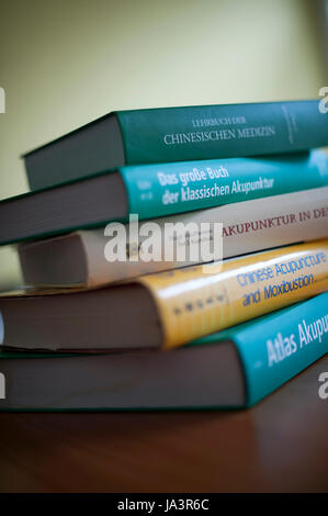 Books on acupuncture and Chinese medicine. - Stock Photo