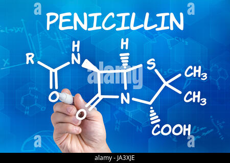 hand with pencil draws chemical structural formula of penicillin - Stock Photo