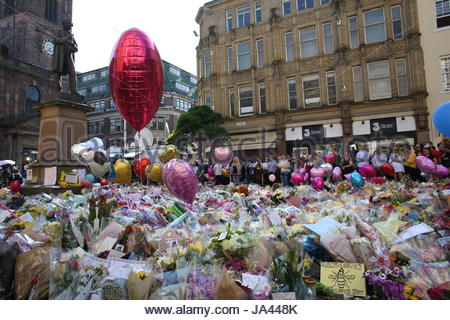 A huge floral memorial in St. Ann's Square in Manchester pays tribute to the victims of the Manchester bombing. - Stock Photo