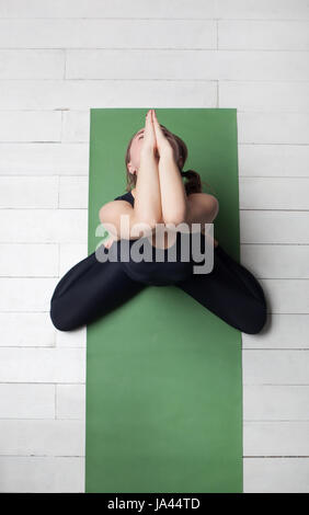 Girl performs asana to the disclosure of the pelvis from yoga - Stock Photo