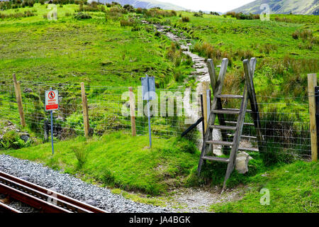 A Stile over fencing on the footpath going up Snowdon, Gwynedd, North Wales, UK. - Stock Photo