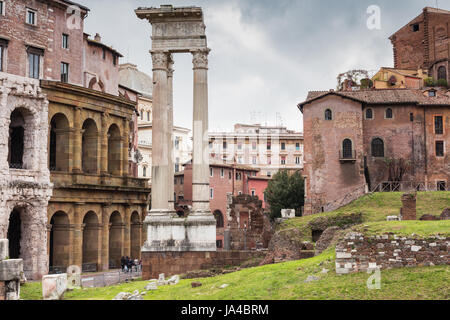 ROME, ITALY - MARCH 19, 2017: Temple of Apollo Sosianus (center) and Theater of Marcellus (left), surrounded by - Stock Photo