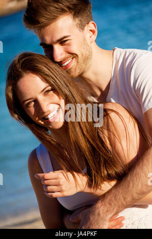 in love happy young couple at the beach in summer - Stock Photo