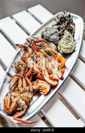 mixed fresh portuguese seafood selection gourmet set platter meal on table - Stock Photo