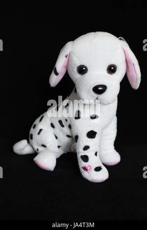 A Dalmatian dog toy with black spots for decoration - Stock Photo