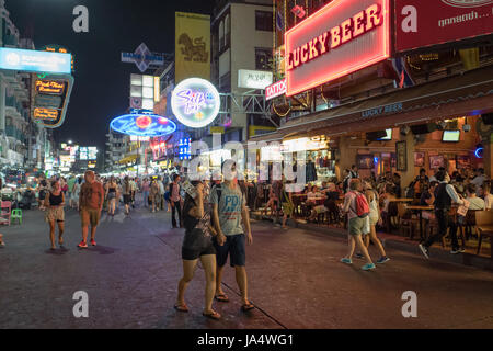 Khao San road by night in Bangkok. This is a world famous backpacker street and a major tourist attraction in Thailand. - Stock Photo