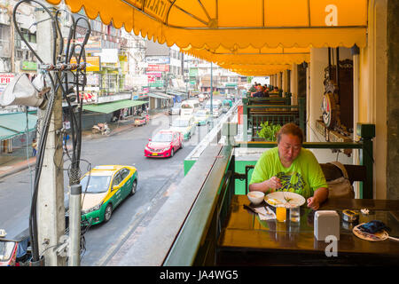 Morning breakfast at Khao San road in Bangkok. This is a world famous backpacker street and a major tourist attraction - Stock Photo