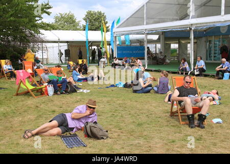 Relaxing outside the Festival Bookshop, Hay Festival 2017, Hay-on-Wye, Brecknockshire, Powys, Wales, Great Britain, - Stock Photo
